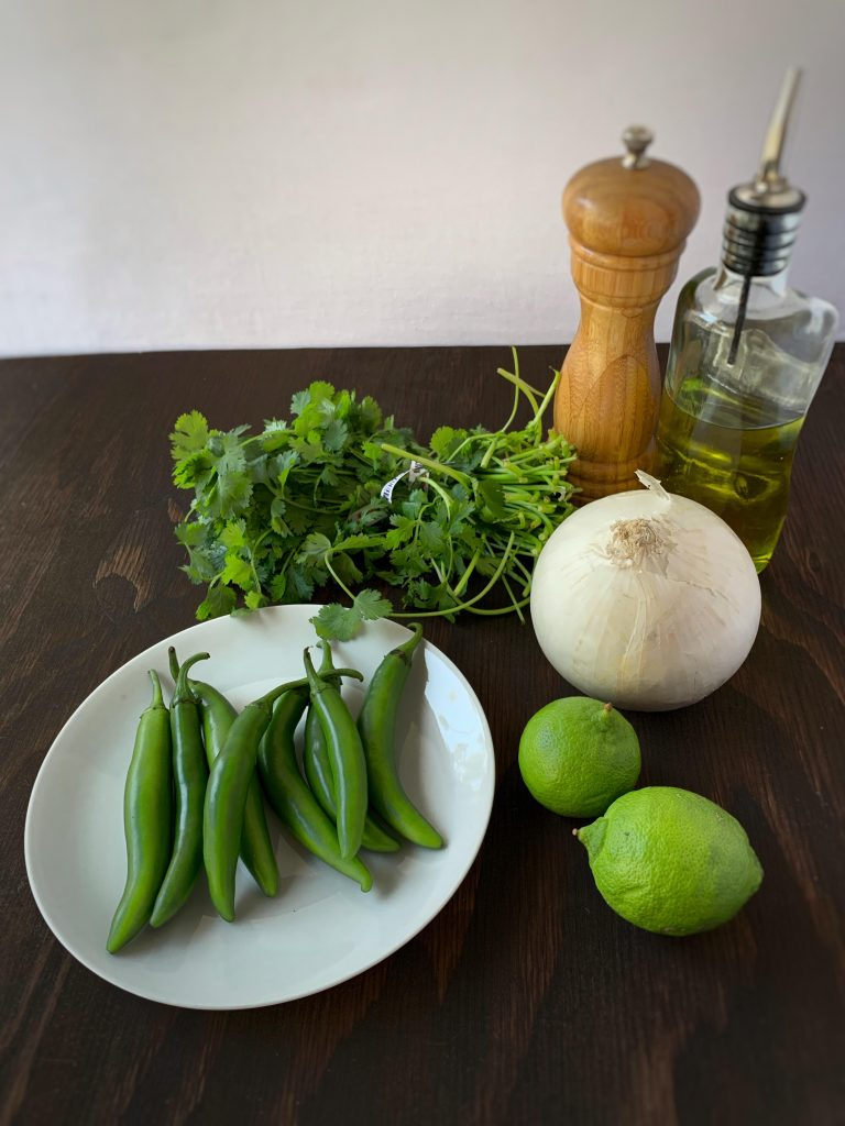 Serrano peppers, limes, white onion, cilantro, olive oil, and salt