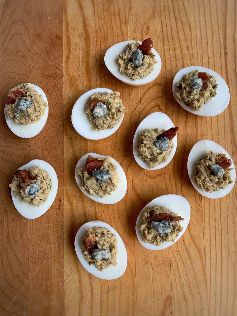 Deviled eggs with bacon and gorgonzola.