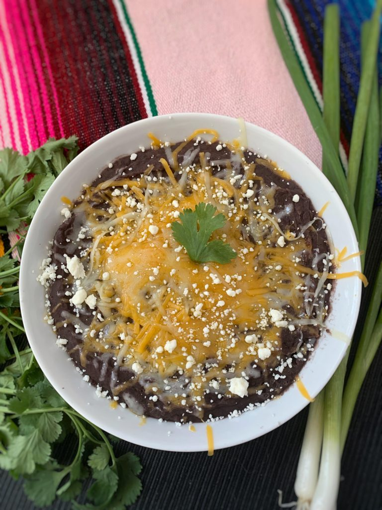 Black refried beans topped with cheese