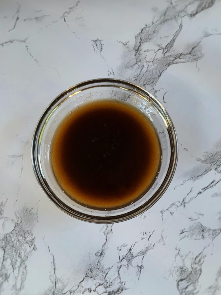 whiskey, maple syrup, and brown sugar mixed in a small bowl