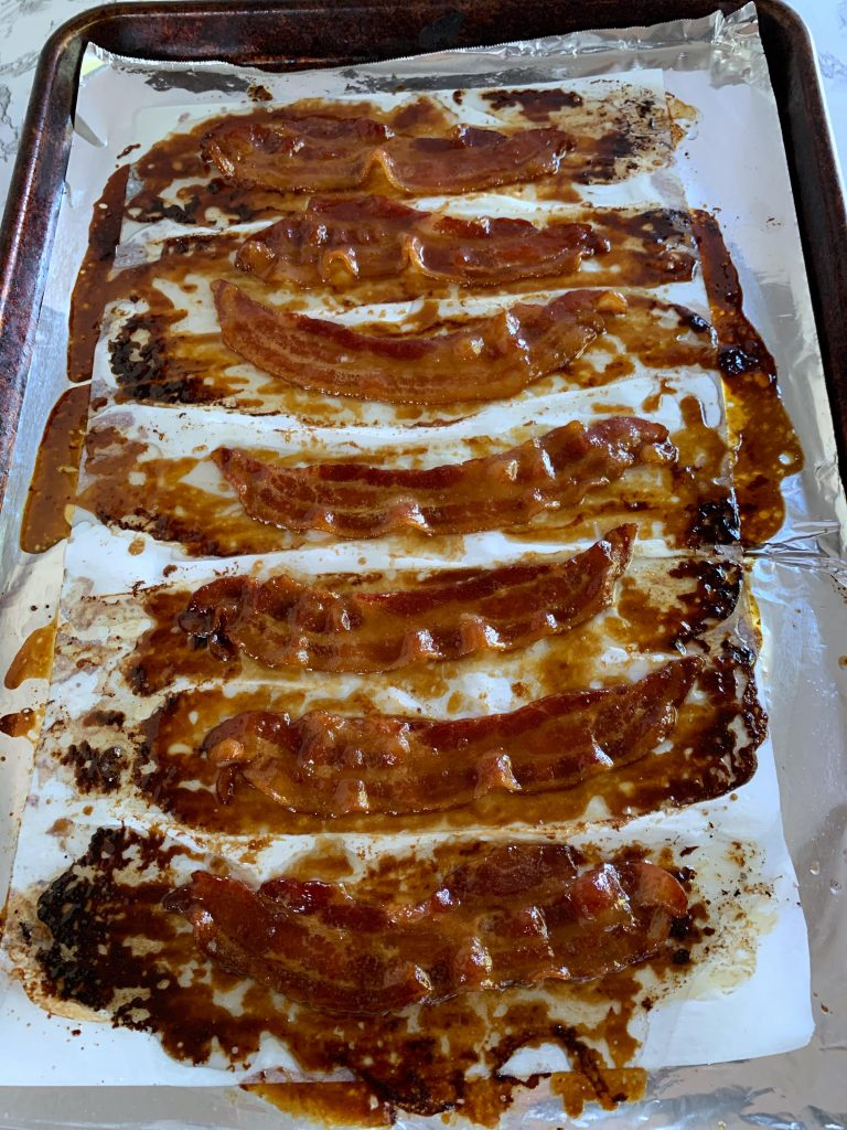 Candied maple bacon on a baking sheet
