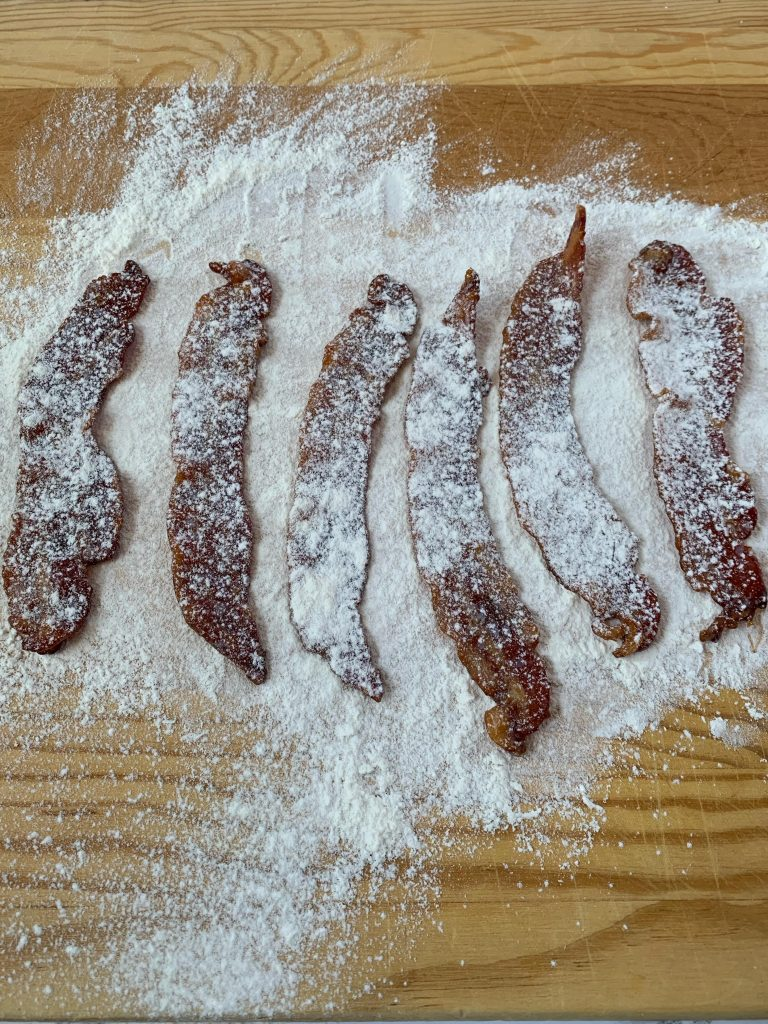 Candied bacon covered with flour