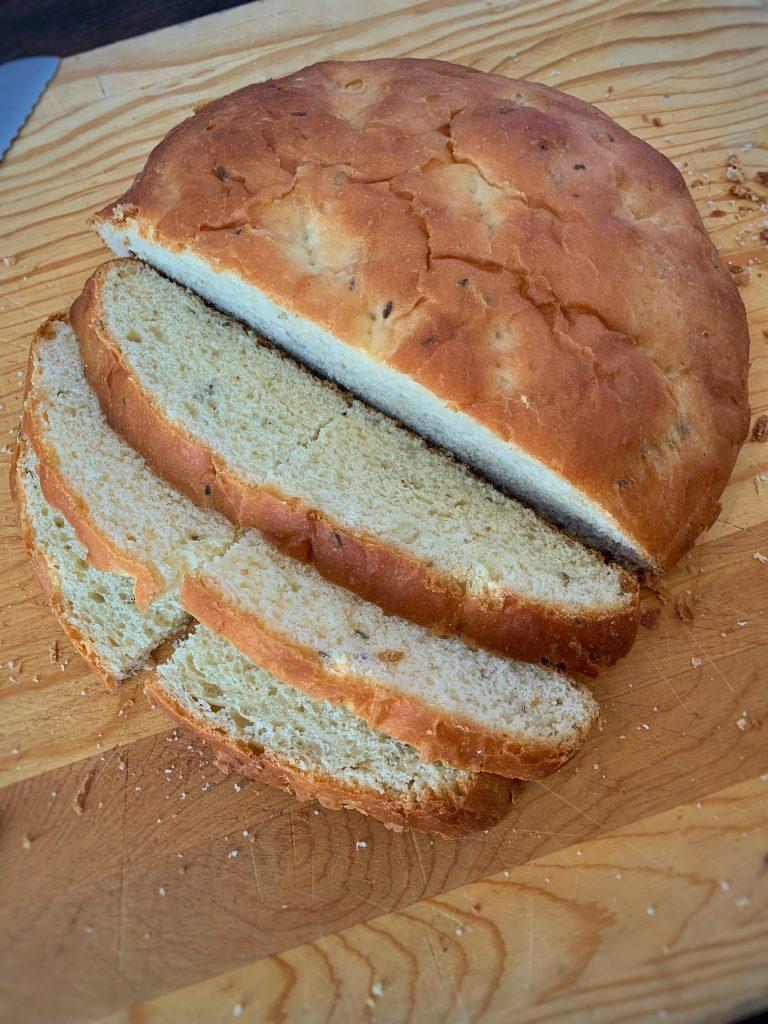 Fennel Bread on a cutting board with a few slices