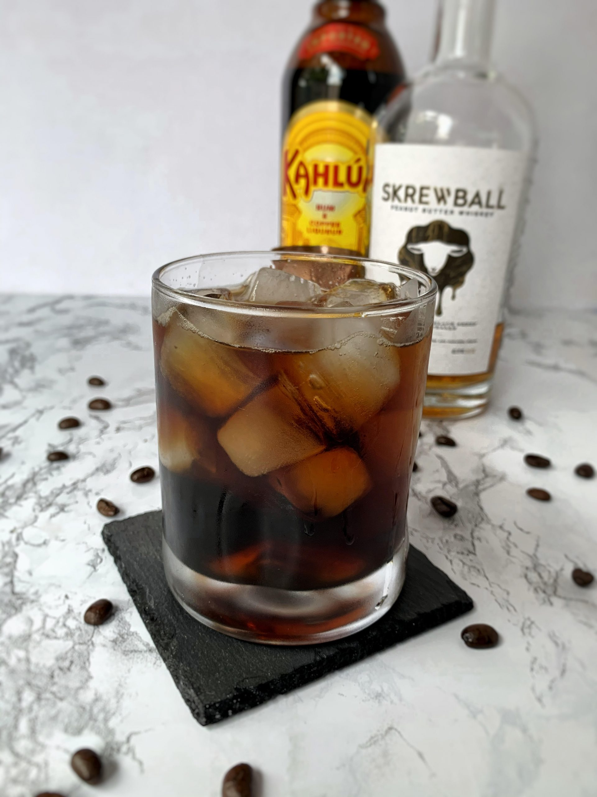 Iced coffee spiked with Skrewball Peanut Butter Whiskey and Kahlua coffee liqueur