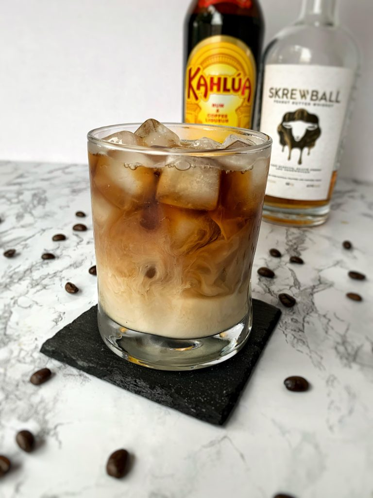 Iced coffee with Skrewball Whiskey, Kahlua, and milk