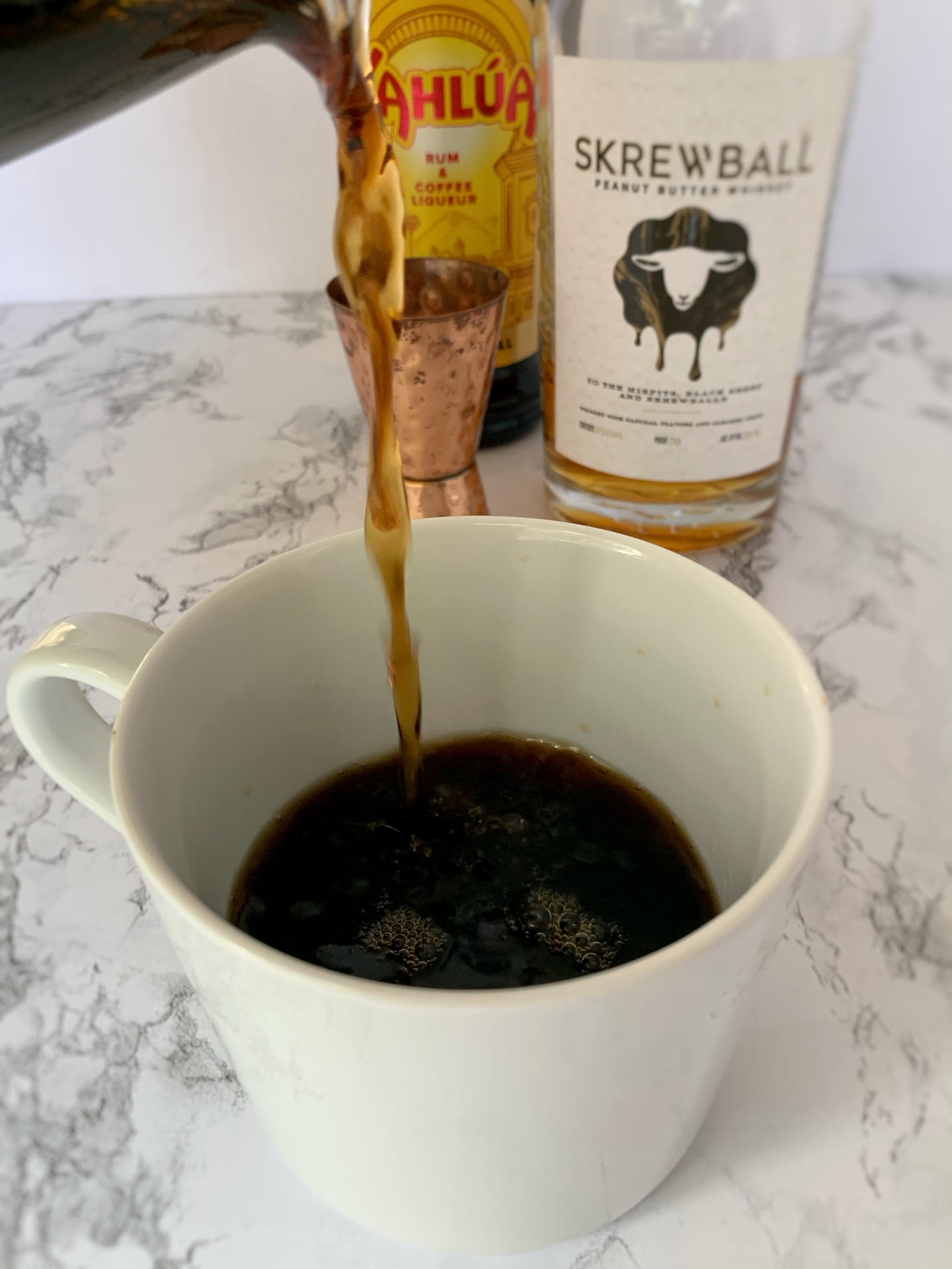 pouring coffee into coffee mug