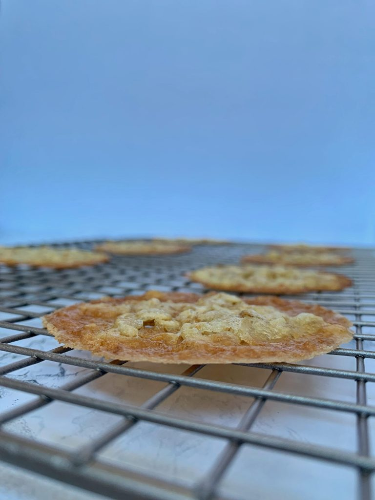Side view of lace cookie on metal cooling rack